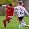 AUGUSTA, ME - OCTOBER 15: ConyÕs Yousif Ibrahim, 10, left, and GardinerÕs Braden Dorogi get tangled as they go for the ball during soccer game Friday October 15, 2021 in Augusta. (Staff photo by Joe Phelan/Staff Photographer)