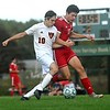 Winslow's Sam Schmitt, left, and Cony's Jakob Varney battle for the ball during boys soccer action Monday in Augusta.  — Rich Abrahamson/Morning Sentinel
