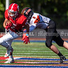 OAKLAND, ME - SEPTEMBER 18: Cony running back Conner Heidle, left, gets tackled by Brunswick defensive back Quin Mccaffery during a football game Saturday September 18, 2021 in Oakland. (Staff photo by Joe Phelan/Staff Photographer)