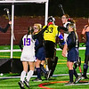 TOPSHAM, ME - OCTOBER 27: <br /> Mt. Ararat Eagles Lily Koslosky, left, (6), Audrey Marchildon (13) and Paige Witwicki (5) celebrate after Witwicki scored third quarter goal to put Eagles up 1-0 over Mt. Blue Cougars during a Class A North playoff game on Wednesday October 27, 2021 on Mt. Ararat High School's Stadium Field in Topsham. (Staff photo by Joe Phelan/Staff Photographer)