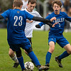 CHINA, ME - OCTOBER 26: Cape Elizabeth's Ander Erickson, center, gets double teamed by Erskine Academy's Cooper Grondin, left, and Emmet Appel during a Class B South soccer quarterfinal game Tuesday October 26, 2021 at Erskine Academy in China. (Staff photo by Joe Phelan/Staff Photographer)