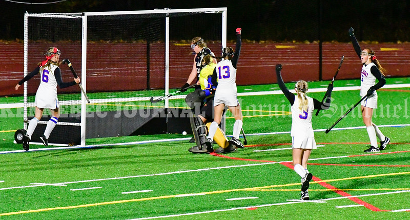 TOPSHAM, ME - OCTOBER 27: <br /> Mt. Ararat Eagles celebrate after Audrey Marchildon (13), center, scored a third quarter goal to put Eagles up 2-0 over Mt. Blue Cougars during a Class A North playoff game on Wednesday October 27, 2021 on Mt. Ararat High School's Stadium Field in Topsham. (Staff photo by Joe Phelan/Staff Photographer)