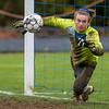 CHINA, ME - OCTOBER 26: Erskine Academy goal keeper Timber Parlin misses a penalty kick by Cape Elizabeth's <br />  during a Class B South soccer quarterfinal game Tuesday October 26, 2021 at Erskine Academy in China. (Staff photo by Joe Phelan/Staff Photographer)