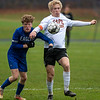 CHINA, ME - OCTOBER 26: Erskine Academy's Wes McGlew, left, and Cape Elizabeth's Tiernan Lathrop chase a ball during a Class B South soccer quarterfinal game Tuesday October 26, 2021 at Erskine Academy in China. (Staff photo by Joe Phelan/Staff Photographer)