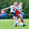 AUGUSTA, ME - SEPTEMBER 21: Gardiner 10 Ella Shaw<br /> and Cony 17 Dina Wadleigh kick the ball during a soccer game Tuesday September 21, 2021 at the CAYSA field in Augusta. (Staff photo by Joe Phelan/Staff Photographer)