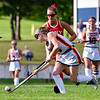 GARDINER, ME - SEPTEMBER 7: Cony's Mallory Audette, top, chase after Gadriner's Addison Carter during a field hockey game Tuesday September 7, 2021 on Somerville Field in Gardiner. (Staff photo by Joe Phelan/Staff Photographer)