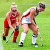 GARDINER, ME - SEPTEMBER 7: Cony's Madison Veilleux, left, tries to take ball away from Gardiner's Piper Lavoie during a field hockey game Tuesday September 7, 2021 on Somerville Field in Gardiner. (Staff photo by Joe Phelan/Staff Photographer)