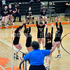 GARDINER, ME - SEPTEMBER 29: Official signals they got the point as the Gardiner Tigers celebrate during a volleyball match Wednesday September 29, 2021 in the in the James A. Bragoli Memorial Gym at Gardiner Area High School. (Staff photo by Joe Phelan/Staff Photographer)