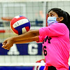 OAKLAND, ME - SEPTEMBER 14: Cony's Zainab Albraihi  hits the ball during a volleyball game  Tuesday September 14, 2021 at Messalonskee High School in Oakland. (Staff photo by Joe Phelan/Staff Photographer)