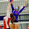 OAKLAND, ME - SEPTEMBER 14: Cony's Kristin Merrill, puts ball up as Messalonskee's Candace Pelotte tries to block during a volleyball game Tuesday September 14, 2021 at Messalonskee High School in Oakland. (Staff photo by Joe Phelan/Staff Photographer)