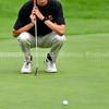 BRUNSWICK, ME - SEPTEMBER 30: Brunswick's Austin Stromick lines up putt during KVAC golf championship Thursday September 30, 2021 at Brunswick Golf Club. (Staff photo by Joe Phelan/Staff Photographer)