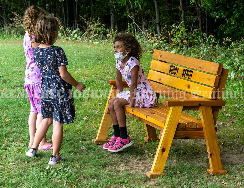 FAYETTE, ME - SEPTEMBER 24: When Izabella Fleming-Douglas (CQ), right, sat new buddy bench Friday September 24, 2021 Millie Laverdiere, right, and Ava Smith came over to chat with her on playground at Fayette Elementary School in Fayette. The girls discussed what to play next and then they ran off together. (Staff photo by Joe Phelan/Staff Photographer)