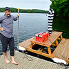 WINTHROP, ME - SEPTEMBER 1: After taking it out for spin, Lon Cameron talks about his floating picnic table watercraft during an interview Wednesday September 1, 2021 on Wilson Pond in Winthrop. (Staff photo by Joe Phelan/Staff Photographer)
