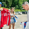 LEWISTON, ME - AUGUST 6:   <br /> Bruce Bickford, right, and his children Landon, left, and Hannah, look through some of his Team USA gear from 1988 before posing for a photo Friday August 6, 2021 in Lewiston. One of the Kappa jackets still had the label on it. Bickford ran the 10,000 meters for Team USA at 1988 Olympics in Seoul, South Korea. (Staff photo by Joe Phelan/Staff Photographer)