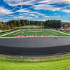 AUGUSTA, ME - OCTOBER 13:  Geo Surfaces workers cut out the green part under football yard line markers Wednesday October 13, 2021 on Cony High SchoolÕs Fuller Field in Augusta. After carefully measuring and positioning the name, numbers and markings are nailed in place on top of the green and left to settle for a day. After that workers cut out the green part underneath and slide them in. (Staff photo by Joe Phelan/Staff Photographer)