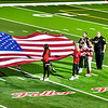 AUGUSTA, ME - OCTOBER 16: People hold an American flag during National Anthem before a football game Saturday October 16, 2021 on Cony's Fuller Field in Augusta. (Staff photo by Joe Phelan/Staff Photographer)
