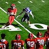 AUGUSTA, ME - OCTOBER 16: Cony Dominick Napolitano, left, is about to get tackled by Lawrence's Cade Scott at 40 yard line on new turf field during <br /> football game Saturday October 16, 2021 on Cony's Fuller Field in Augusta. (Staff photo by Joe Phelan/Staff Photographer)