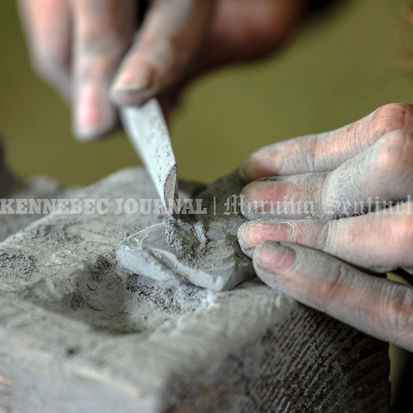 HALLOWELL, ME - SEPTEMBER 17: Mira DiSilvestro files a stone while making her own stone carvings during Hallowell Granite Symposium Friday September 17, 2021 at Stevens Commons in Hallowell.  (Staff photo by Joe Phelan/Staff Photographer)
