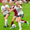 MONMOUTH, ME - OCTOBER 5: Monmouth/Winthrop's Izzy Hamann, center, is double teamed by Hall-Dale's Ella Schaab, left, and Hayden Madore, right, during a soccer game Tuesday October 5, 2021 at Monmouth Academy. (Staff photo by Joe Phelan/Staff Photographer)