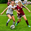 MONMOUTH, ME - OCTOBER 5: Hall-Dale's Ella Schaab, left, and Monmouth/Winthrop's Izzy Hamann fight for a ball during a soccer game Tuesday October 5, 2021 at Monmouth Academy. (Staff photo by Joe Phelan/Staff Photographer)
