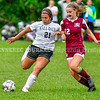 MONMOUTH, ME - OCTOBER 5: Hall-Dale's Kayla Lee, left, and Monmouth/Winthrop Elsa Goebel-Bain fight for the ball during a soccer game Tuesday October 5, 2021 at Monmouth Academy. (Staff photo by Joe Phelan/Staff Photographer)