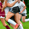 MONMOUTH, ME - OCTOBER 5: A teammate hugs Hall-Dale's Marie Benoit after Benoit scored game winning goal to put Bulldogs up 3-2 over Monmouth/Winthrop during a soccer game Tuesday October 5, 2021 at Monmouth Academy. (Staff photo by Joe Phelan/Staff Photographer)