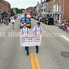 HALLOWELL, ME - JULY 17: James Moorhead, left, and his husband Clyne Hodges carry Hallowell Pride Alliance banner during the Hallowell Pride parade Saturday July 17, 2021 on Water Street in Hallowell. (Staff photo by Joe Phelan/Staff Photographer)