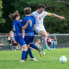 CHINA, ME - SEPTEMBER 23: Erskine Academy's Caleb Cyr, left, 10, Brady Kirkpatrick, 9, and Cony's Gabriel Biasuz tangle during a soccer game Thursday September 23, 2021 at Erskine Academy in China. (Staff photo by Joe Phelan/Staff Photographer)