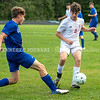 CHINA, ME - SEPTEMBER 23: Erskine Academy Chase Larrabee, 21, left, <br /> knocks ball away from Cohen Parker eduring a soccer game  Thursday September 23, 2021 at Erskine Academy in China. (Staff photo by Joe Phelan/Staff Photographer)