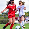 AUGUSTA, ME - SEPTEMBER 21: Cony's Emma Dorion, 8, left, and Gardiner's Dayna Vasoli, 16, battle for control of the ball during a soccer game Tuesday September 21, 2021 at the CAYSA field in Augusta. (Staff photo by Joe Phelan/Staff Photographer)