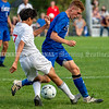 CHINA, ME - SEPTEMBER 23: Cony's Martin Ferrusca, left, 7, and Erskine Academy's Noah Crummett, 18, fight for the ball during a soccer game  Thursday September 23, 2021 at Erskine Academy in China. (Staff photo by Joe Phelan/Staff Photographer)
