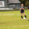 """FARMINGDALE, ME - SEPTEMBER 22: Coach Guy Cousins and girls soccer players laugh while playing a game of """"head, catch, catch, head"""" during practice Wednesday September 22, 2021 at Hall-Dale High School in Farmingdale. (Staff photo by Joe Phelan/Staff Photographer)"""