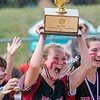 STANDISH, ME - JUNE 19: Sarah Benner and Hall-Dale teammates celebrate with Class C softball state championship trophy Saturday June 19, 2021 on Richard W. Bailey softball field in Standish. (Staff photo by Joe Phelan/Staff Photographer)