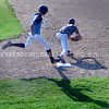 AUGUSTA, ME - AUGUST 6: Capitol Bombers hitter Jackson Leach sprints to first but didn't beat the throw to Topsham 202 first baseman Brady Merrill during Junior Legion tournament Friday August 6, 2021 on McGuire Field in Augusta. (Staff photo by Joe Phelan/Staff Photographer)