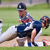 AUGUSTA, ME - AUGUST 7: Topsham shortstop Andrew Clemons, top, tags out Skowhegan baserunner Chance Tibbetts in rundown between second and third bases during Junior Legion tournament Saturday August 7, 2021 on Morton Field in Augusta. (Staff photo by Joe Phelan/Staff Photographer)
