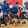 """AUGUSTA, ME - JULY 29: During a drill to practice pack skating, players fall after Jessica """"Jose"""" Clark, top left, held up stop sign during Kennebec Valley Roller Derby practice Thursday July 29, 2021 in the gym of the Buker Community Center in Augusta. Players who fell had to go to middle of track and do five pushups before rejoining the pack. (Staff photo by Joe Phelan/Staff Photographer)"""