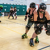 """AUGUSTA, ME - JULY 29: Vanessa """"Necessary Roughness"""" Glazier pushes on teammate Melissa Beatrice who is trying to hold her back during Kennebec Valley Roller Derby practice Thursday July 29, 2021 in the gym of the Buker Community Center in Augusta. (Staff photo by Joe Phelan/Staff Photographer)"""