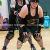 """AUGUSTA, ME - JULY 29: Meredith Cohen, left, pushes teammate Vanessa """"Necessary Roughness"""" Glazier who is practicing a blocking technique during Kennebec Valley Roller Derby practice Thursday July 29, 2021 in the gym of the Buker Community Center in Augusta. (Staff photo by Joe Phelan/Staff Photographer)"""