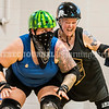 """AUGUSTA, ME - JULY 29: Meredith Cohen, right, pushes teammate Jamie """"Cutter"""" Hoover who is trying to hold her back during Kennebec Valley Roller Derby practice Thursday July 29, 2021 in the gym of the Buker Community Center in Augusta. (Staff photo by Joe Phelan/Staff Photographer)"""