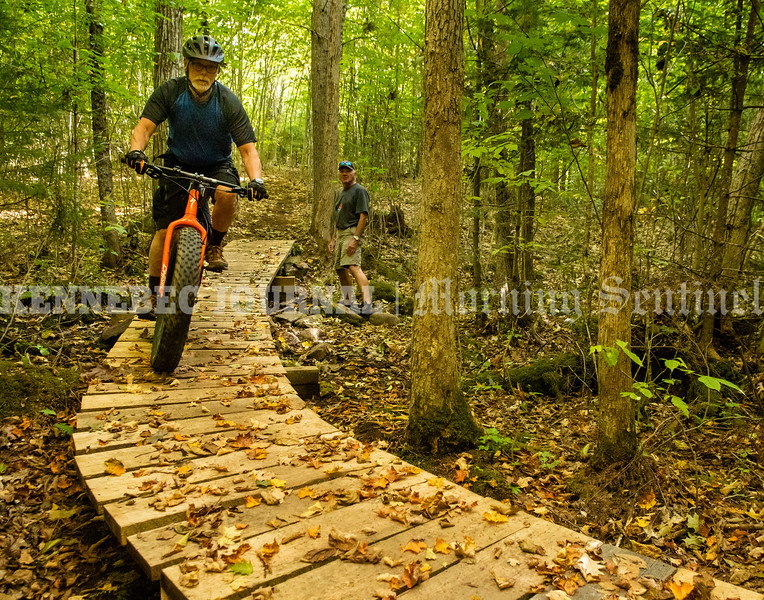 MANCHESTER, ME - SEPTEMBER 21: Manchester selectman Garry Hinckley rides over one of the six bridges in the new trail area as fellow selectman Bob Gasper watches Tuesday September 21, 2021 in Manchester. (Staff photo by Joe Phelan/Staff Photographer)