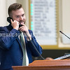 AUGUSTA, ME - JUNE 30: Speaker of the House Ryan Fecteau, D-Biddeford, chats on the phone with Republican House leader Rep. Kathleen Dillingham, R - Oxford, during quorum vote at start of session Wednesday June 30, 2021 at The Maine State House in Augusta. During sessions The Speaker sometimes talks to the leaders of the two major parties on the phone as they sit at their desks in opposite corners of the large chamber. It was the first day of the 130th Legislature that members could attend with out a face covering. (Staff photo by Joe Phelan/Staff Photographer)