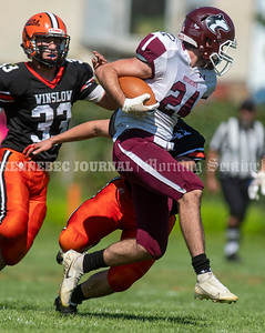 WINSLOW, ME - SEPTEMBER 18: Winslow linebacker Matt Quirion, left, and defensive back Jack Dorval chase down MCI running back Braeden Kennedy during a football game Saturday September 18, 2021 at Gerry Poulin Memorial Field in Winslow. (Staff photo by Joe Phelan/Staff Photographer)
