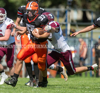 WINSLOW, ME - SEPTEMBER 18: Winslow running back Matt Quirion, left, tries to get away from MCI defensive back Caleb Kennedy during a football game Saturday September 18, 2021 at Gerry Poulin Memorial Field in Winslow. (Staff photo by Joe Phelan/Staff Photographer)