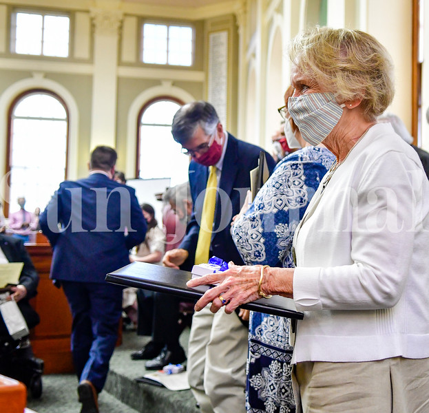 AUGUSTA, ME - SEPTEMBER 7: Patricia Vashon, of Waterville, stands as attendees applaud her induction into Maine Franco-American Hall of Fame Tuesday September 7, 2021 during ceremony at the Maine State House in Augusta. Vashon, who was a language teacher for 36 years in the Winslow school system. was one of 12 inductees. The late Rev. Lionel Gerard Chouinard, who was pastor at St. Augustine's Catholic Church, was also added to the Hall. Gov. Janet Mills and French Ambassador to the United States  Philippe Étienne were among the speakers. (Staff photo by Joe Phelan/Staff Photographer)