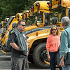 READFIELD, ME - SEPTEMBER 3: Driving instructor Patti Springer, center, chats with bus driving student Zach Farnham, left, and Dennis Dalheim, right, Friday September 3, 2021 at the Maranacook School bus depot in Readfield. Springer, who's also a Maranacook bus driver, taught the men's class over the summer and was doing a review with them before they take state license test next week. (Staff photo by Joe Phelan/Staff Photographer)
