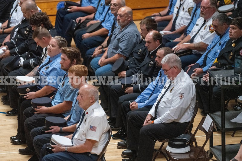 MADISON, MAINE- AUGUST 28, 2021<br /> Firefighters from Anson Fire Department along with other area firefighters pay tribute to former Anson firefighter and fire chief, Gary Ward at Madison area at Madison Area Memorial High School on Saturday, August 28, 2021.  (Staff Photo by Michael G. Seamans/Staff Photographer)