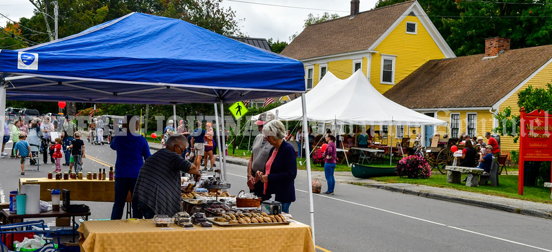 MONMOUTH, ME - SEPTEMBER 25: People stand in the closed Main Street during Applefest Saturday September 25, 2021 at the Monmouth Museum. (Staff photo by Joe Phelan/Staff Photographer)