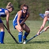 WINTHROP, ME - SEPTEMBER 8: Oak Hill's Julie Mooney, left, Cassie Steckino and Winthrop's Maddie Perkins converge on the ball during a field hockey game Wednesday September 8, 2021 on Kelsey Ann Stoneton Memorial Field in Winthrop. (Staff photo by Joe Phelan/Staff Photographer)