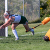 WINTHROP, ME - SEPTEMBER 8: A shot by Olivia Staggs, left, is deflected by Winthrop's Rhyan Sawlivich as goalkeeper Elle Folsom moves in during a field hockey game Wednesday September 8, 2021 on Kelsey Ann Stoneton Memorial Field in Winthrop. (Staff photo by Joe Phelan/Staff Photographer)