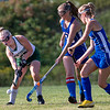 WINTHROP, ME - SEPTEMBER 8: Winthorp's Madeline Wagner, left, tries to pass past Oak Hill defenders Brianna Dumais, left, and Julia Lane during a field hockey game Wednesday September 8, 2021 on Kelsey Ann Stoneton Memorial Field in Winthrop. (Staff photo by Joe Phelan/Staff Photographer)